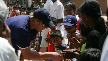 Shane Warne visiting a tsunami refugee camp in southern Sri Lanka in 2005. The Shane Warne Foundation donated money to the aid effort.