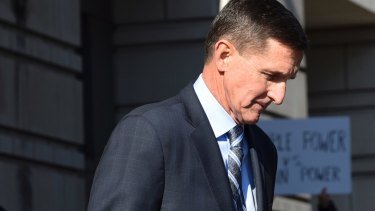 Former Trump national security adviser Michael Flynn leaves court in Washington after pleading guilty to lying to the FBI.