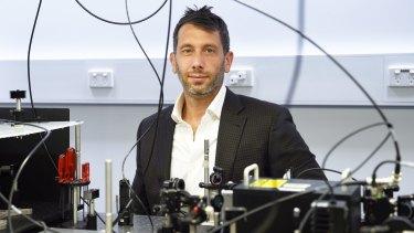 Associate Professor Michael Biercuk in his laboratory.