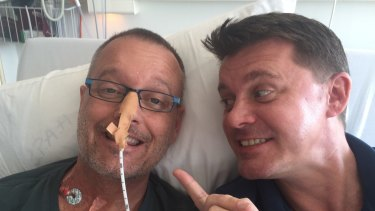 Neil Pennock (right) with his late partner Trace Richey, who died after a transplant failure.