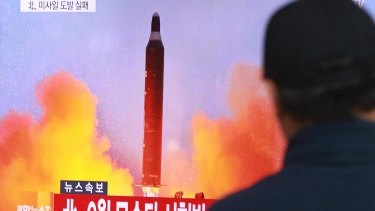 A man watches a TV news program on North Korea's missile launches at Seoul Railway Station, South Korea.