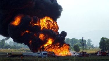 Revealed as a cyber attack: Firemen struggle to extinguish the fire at the Baku-Tbilisi-Ceyhan pipeline near the eastern Turkish city of Erzincan on August 7, 2008.