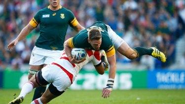 Down to earth Japan's Ayumu Goromaru tackles Jean De Villiers of South Africa.