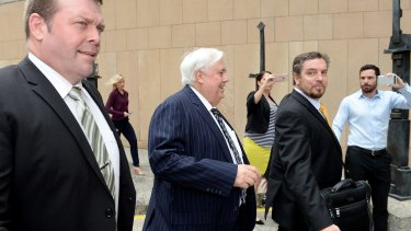 Mr Palmer was flanked by security for his third Federal Court appearance.