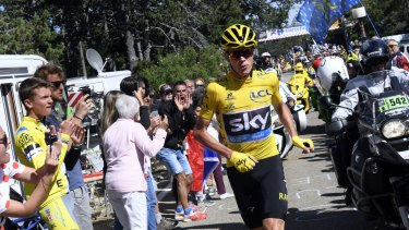 Britain's Chris Froome runs after he crashed at the end of the 12th stage of the Tour de France.