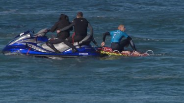 The other Mick Fanning with rescuers after the shark attack.