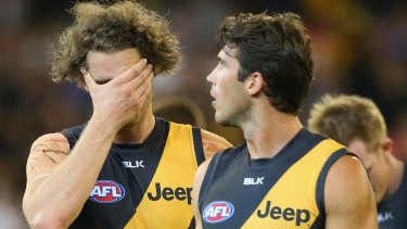 Questions are mounting around key forward Ty Vickery,left, with Alex Rance.