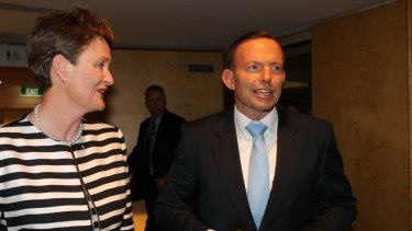Business Council president Catherine Livingstone talks with Prime Minister Tony Abbott.