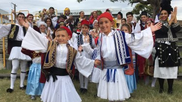 The face of Paniyiri Festival 2017 Niko Kalligeros (front left) and Dimitri Kastrissios (front right) with fellow Hellenic dancers.