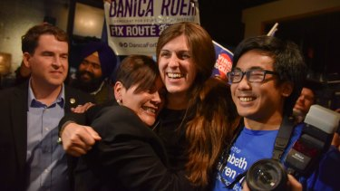 Danica Roem, centre, who ran for the house of delegates in Virginia became the first openly transgender in a state legislature in the United States.