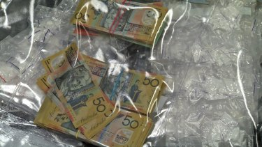 Cash and drugs seized during raids in 2015.
