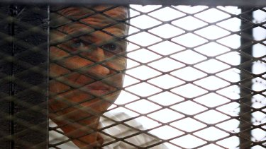 Jailed journalist Peter Greste in the defendant's cage in court earlier this year.