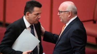 Senator Nick Xenophon with Attorney-General Senator George Brandis in the Sentate on Friday.