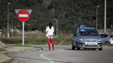 Prostitutes waiting for clients on the roadside are a common sight in France where brothels are illegal.