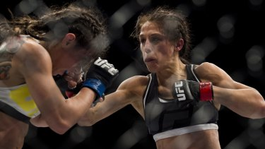 Joanna Jedrzejczyk throws a punch against Claudia Gadelha during The Ultimate Fighter Finale at MGM Grand Garden Arena on July 8, 2016.