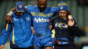Facing a stint on the bench: Semi Radradra is helped from the field on Friday night.