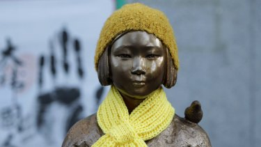 "A statue of a girl symbolising the issue of ""comfort women"" in front of the Japanese Embassy in Seoul."