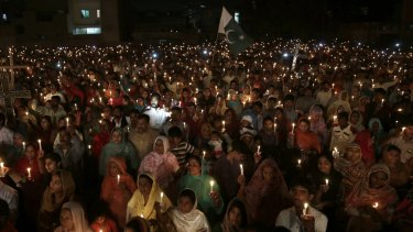 Pakistani Christians hold candles during a vigil for victims of a suicide bombing in Lahore in March.