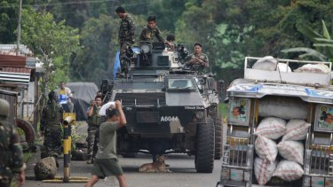 Soldiers prepare for deployment on the outskirts of Marawi city, southern Philippines.