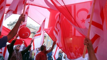 Turkish Cypriot demonstrators at the mass rally in support of Turkey's Prime Minister Recep Tayyip Erodgan.