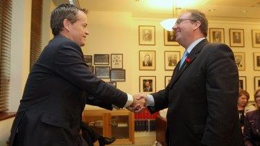 Happier times: Opposition Leader Bill Shorten congratulates David Feeney at the Labor caucus.