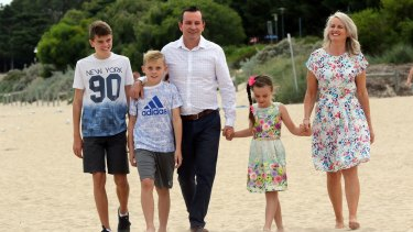 WA's next premier, Mark McGowan, on Rockingham Beach, near Perth, with his wife Sarah and children Samuel, 13, Alexander, 11, and Amelia, 7, on Sunday.