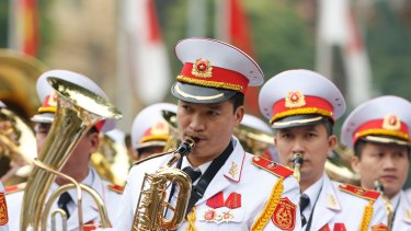 Military music band play before a welcoming ceremony for Japan's Prime Minister Shinzo Abe at the Presidential Palace in Hanoi.