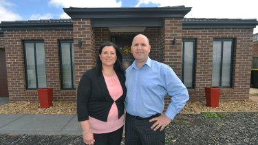 Shelley and Earl Softley in front of their Melton home.