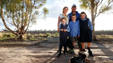 Bek and Jed Cullen with the children, Pippa, 6, Jock, 8 and Molly, 10, on the property near Walgett.