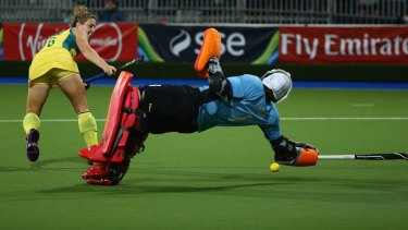 Saved: Maddi Hinch blocks a mishit by Kellie White in the penalty shoot-out.