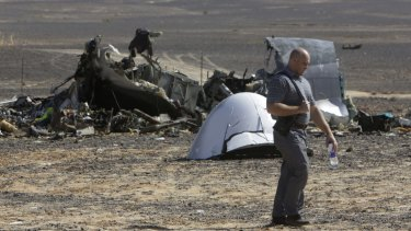 A Russian investigator inspects the Egyptian site where the plane crashed.