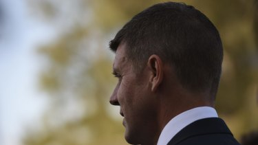Admitted his office called the bank: Premier Mike Baird.