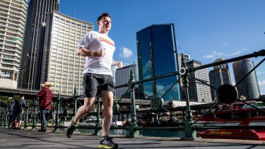 Neil Pennock prepares for the City2Surf at Circular Quay. He is hoping to raise the $60,000 needed to complete fitting out a room in a bone marrow ward.
