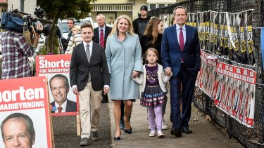 Old-fashioned people power: Bill Shorten votes in Marribyrnong with his wife Chloe and their family.