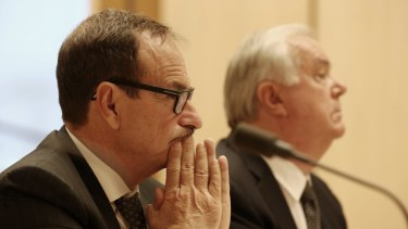 Michael Smith, 7-Eleven chairman, and Russell Withers, 7-Eleven owner, at the Senate inquiry in February.