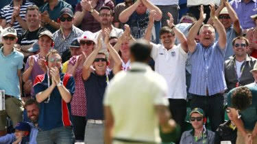 The crowd applaud Mitchell Johnson as he concedes his 100th run.