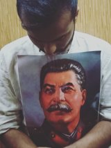 Jay Tharappel, a protege of Tim Anderson at the University of Sydney, with a picture of Soviet dictator Joseph Stalin.