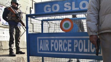Indian security forces stand guard outside Pathankot air base.