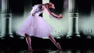 Water floods the stage like tears during Natalia Osipova's performance. Photo: Regis Lansac
