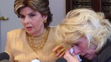 Heather Kerr, a former actress weeps her attorney Gloria Allred speaks at a press conference.