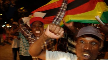 Zimbabweans celebrate in neighbouring Hillbrow, Johannesburg, South Africa.