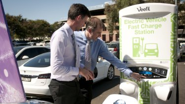 Energy Minister Mark Bailey with Tritium managing director Dr David Finn at the charging station.