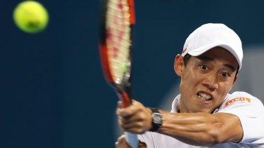Disappointing result: Kei Nishikori returns fire against Dimitrov.