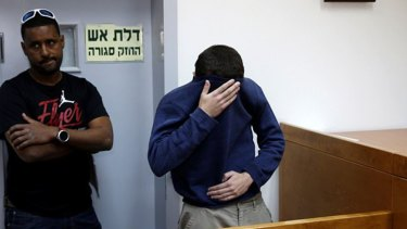 Michael Ron David Kadar, pictured in an Israeli court, was arrested after allegedly threatening schools, airlines, hospitals and Jewish centres in the US, Britain, Australia, New Zealand and Israel.