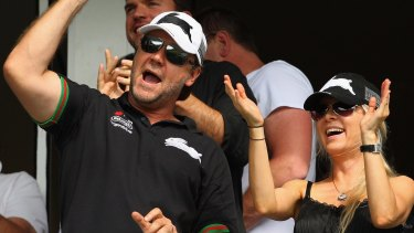 Happier times: Russell Crowe and his then wife Danielle Spencer celebrate a Rabbitohs try in 2009.