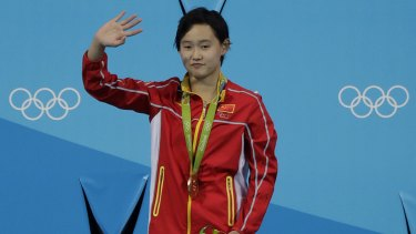 League of her own: China's gold medalist Ren Qian, 15, waves from the podium.