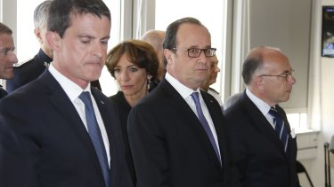 French Prime Minister Manuel Valls, left, French President Francois Hollande and Interior Minister Bernard Cazeneuve attend a meeting the day after the Bastille Day truck attack.