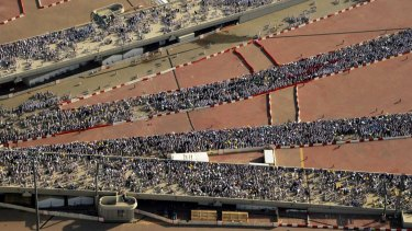 Hundreds of thousands of Muslim pilgrims make their way to cast stones at a pillar symbolising the stoning of Satan in a ritual called Jamarat, the last rite of the annual haj.