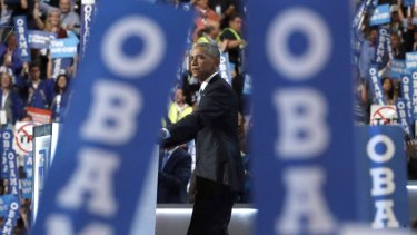 The crowd watches President Barack Obama as he speaks during the Democratic National Convention.