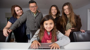 Susan and Phillip Sohn with their children Ella, Phillip and Sophia n their Avoca North home on the Central Coast.